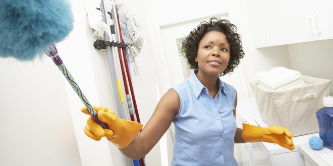 a woman cleaning her laundry room